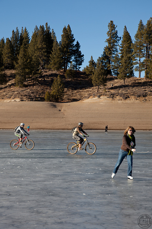 """Ice skaters and bikers on Prosser Reservoir 1"" - These ice skater and mountain bikers were photographed on a frozen Prosser Reservoir, Truckee."