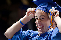 As James Elliott Seager demonstrates it's time to put the cap on for commencement exercises at Meadowbrook Pavilion for Gilford High School graduating seniors.  (Karen Bobotas/for the Laconia Daily Sun)
