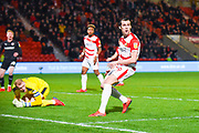 John Marquis of Doncaster Rovers (9) reacts to his shot saved by Adam Davies of Barnsley (1) during the EFL Sky Bet League 1 match between Doncaster Rovers and Barnsley at the Keepmoat Stadium, Doncaster, England on 15 March 2019.