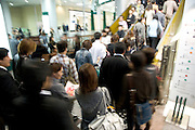 crowd on Friday evening going up by way of escalator to a shopping mall Tokyo Japan