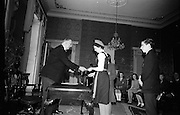 "28/04/1966<br /> 04/28/1966<br /> 28 April 1966<br /> President Eamon de Valera presents prizes at Aras an Uachtarain. The President presented the prizes to the winners of competitions for schoolchildren organised by the Golden Jubilee 1916 Committee. The winners from schools all over Ireland competed in competitions for essays and poetry in Irish and English. Picture shows President de Valera presenting a joint 2nd prize for Essay in English to Caitlin Ní Fhingealtúin, Baile an Gharraí, Durlas Eile, Co. Thiobraid Arann, appeal of Clochar na Toirbhirte. Other receivers were Clara Ní Chonghaile, 8 Sraid Oilibhéar Pluincéad, Loch Garman and Cathal Brugha, ""Ceann Slé"", 30 Bothar an Ruaphoic, Dun Droma, Baile Atha Cliath of Colaiste Gonzaga."