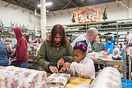 "20181203, Monday, December 3, 2018, North Easton, MA, USA; The Christmas program at My Brother's Keeper in Easton is planning to serve over 3,000 families with over 12,000 parents and children for 2018.<br />  <br /> The regional Christian Ministry, based in North Easton Massachusetts, began the first full day of the annual volunteer-fueled Christmas program when there will be a warehouse facility full of wrapping volunteers and gifts waiting to be selected and wrapped.<br /> <br /> The charity gift giving and wrapping program, in it's 28th year, is ongoing in ""Santa's Workshop"" during the Advent season 11 a.m. to 8 p.m. each day.<br /> <br /> ( 2018 © lightchaser photography )"