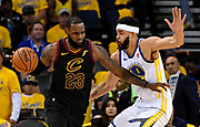May 31, 2018; Oakland, CA, USA; Cleveland Cavaliers forward LeBron James (23) handles the ball against Golden State Warriors center JaVale McGee (1) during the third quarter in game one of the 2018 NBA Finals at Oracle Arena.
