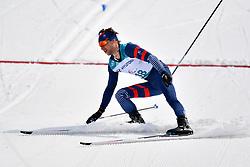 DAVIET Benjamin FRA LW2 competing in the ParaSkiDeFond, Para Nordic Skiing, 20km at  the PyeongChang2018 Winter Paralympic Games, South Korea.