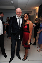 SIR TOM HUNTER and LISA REUBEN at The Reuben Foundation and Virgin Unite Haiti Fundraising dinner held at Altitude 360 in Millbank Tower, London on 26th May 2010.