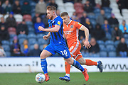Callum Camps brings the ball forward during the EFL Sky Bet League 1 match between Rochdale and Shrewsbury Town at Spotland, Rochdale, England on 9 March 2019.