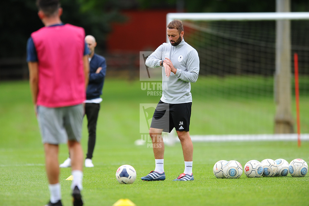 TELFORD COPYRIGHT MIKE SHERIDAN Coach Jamie Haynes checks his watch as AFC Telford United return to training at Lilleshall National Sports Centre on Saturday, July 4, 2020.<br /> <br /> <br /> Picture credit: Mike Sheridan/Ultrapress<br /> <br /> MS202021