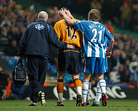 Photo: Ed Godden.<br />Manchester United v Wigan Athletic. The Carling Cup Final. 26/02/2006. Wigan keeper, Mike Pollitt leaves the field injured.