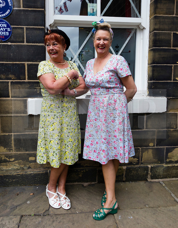 © Paul Thompson licensed to London News Pictures. 16/05/2015. Haworth, West Yorkshire, UK. Two women in costume during Haworth 1940s weekend, an annual event in which people dress in period costume and visit the village of Haworth to relive the 1940s.  Photo credit : Paul Thompson/LNP