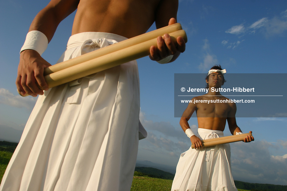 "Hiroaki Kishino (foreground) and Ryohei Taki (rear of photo) , of 'TAO Drummers', performing and practising their ""Sunrise Live"" concert at their home at 'Grandioso', on Mount Kuju, Japan 08.07.04.Hiroaki Kishino (on left) and Ryohei Taki (on right) , of 'TAO Drummers', performing and practising their ""Sunrise Live"" concert at their home at 'Grandioso', on Mount Kuju, Japan 08.07.04"