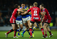 Nathaniel Peteru (C) of Leeds Rhinos on the attack against Craig Kopczak and Tyrone McCarthy of Salford Red Devils during the Super 8s Qualifiers match at Emerald Headingley Stadium, Leeds<br /> Picture by Stephen Gaunt/Focus Images Ltd +447904 833202<br /> 14/09/2018