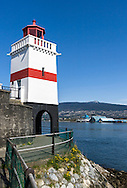 The Brockton Point Lighthouse and the Stanley Park Seawall at Brockton Point in Stanley Park, Vancouver, British Columbia, Canada