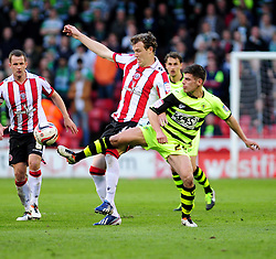 Yeovil Town's Joe Edwards challenges Sheffield United's Kevin McDonald - Photo mandatory by-line: Dougie Allward/JMP - Tel: Mobile: 07966 386802 03/05/2013 - SPORT - FOOTBALL - Bramall Lane - Sheffield - Sheffield United V Yeovil Town - NPOWER LEAGUE ONE PLAY-OFF SEMI-FINAL FIRST LEG