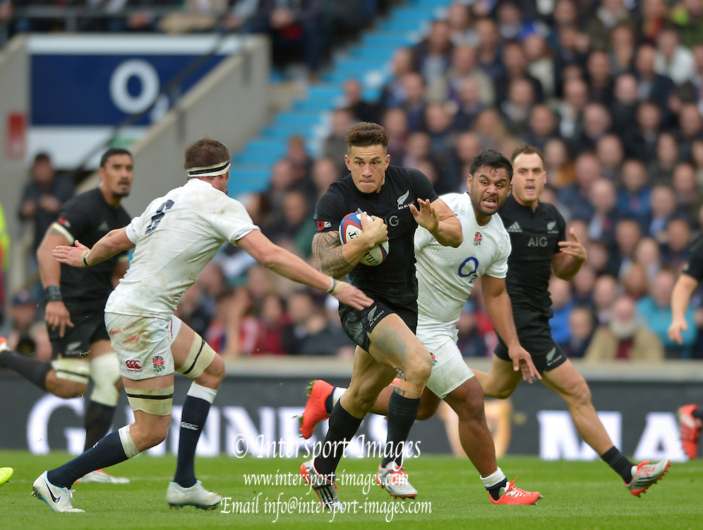Twickenham, Great Britain, New Zealand' s Sonny Boy WILLIAMS, breaking though No.6. Tom WOODS and Billy VUNIPOLA,  during the QBE Autumn International England vs New Zealand, RFU Stadium Twickenham, Surrey.  Saturday 08/11/2014 [Mandatory Credit; Peter SPURRIER/Intersport Images]
