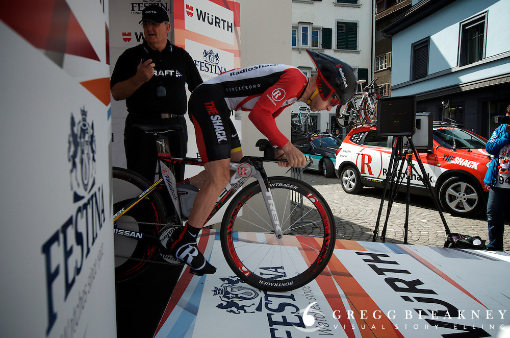 """Leipheimer at the start of a stage he won't likely ever forget.  In the moments before departure he seemed both focused and relaxed.  After realizing that he was still wearing his warm-up jacket, and that his team soigners had left him alone to prepare for the start he joked, """"Hey, I think my team just ditched me.""""  He asked a race official to take his jacket to the RadioShack chase car and TTed his way into GC victory by a scant 4 seconds."""