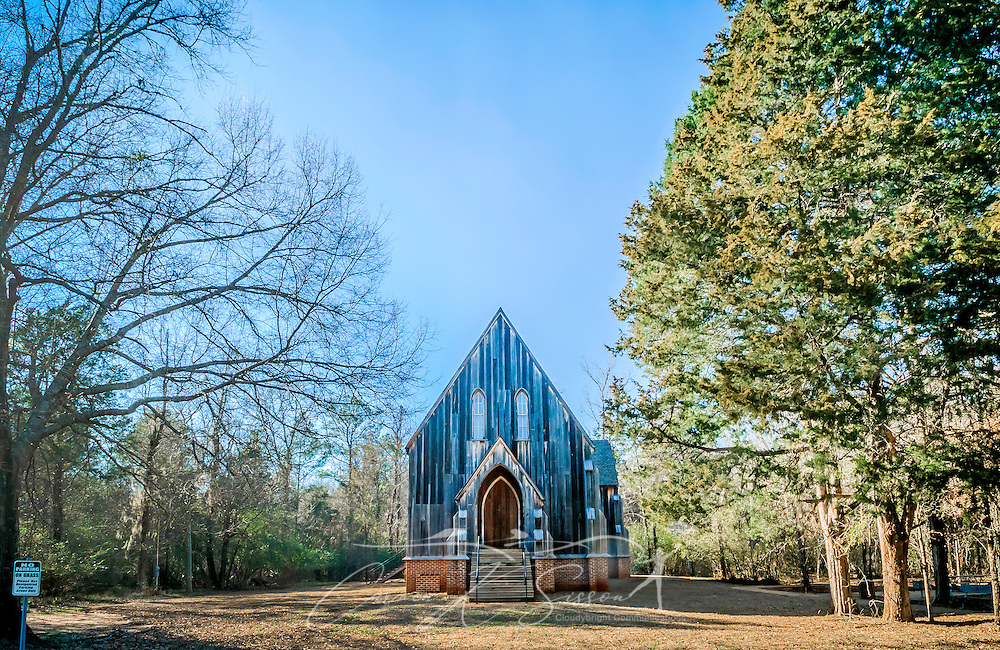 """St. Luke's Episcopal Church is pictured, Feb. 7, 2015, at Old Cahawba Archaeological Park in Orrville, Alabama. The Carpenter Gothic church was designed by Richard Upjohn and built in 1854. It was relocated to Old Cahawba Archaeological Park in 2007. The church is listed in the National Register of Historic Places and is owned by the Alabama Historical Commission. Cahaba, also known as """"Old Cahawba,"""" was Alabama's state capital from 1819-1826 but was abandoned after the Civil War. It is now considered a ghost town. It is located in Dallas County near Selma, Alabama. (Photo by Carmen K. Sisson/Cloudybright)"""