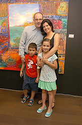 Artist DAMIAN ELWES with his wife LEWANNE ELWES and their children COSIMA and AUBREY at a private view of artist Damian Elwes work 'Artists Studios' held at Scream, 34 Bruton Street, London W1 on 29th June 2006.<br /><br />NON EXCLUSIVE - WORLD RIGHTS