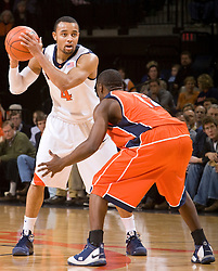 Virginia guard Calvin Baker (4) is guarded by Auburn guard DeWayne Reed (12).  The Auburn Tigers defeated the Virginia Cavaliers 58-56 at the University of Virginia's John Paul Jones Arena  in Charlottesville, VA on December 20, 2008.  (Special to the Daily Progress / Jason O. Watson)