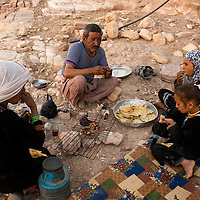 Suleiman, his sister Noora and the two girls enjoying meat and bread before the arrival of the guests