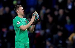 Arsenal goalkeeper Bernd Leno applauds the fans at the end of the match