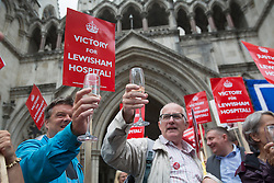 © licensed to London News Pictures. London, UK 31/07/2013. Save Lewisham Hospital Campaigners celebrating with champagne as the High Court quashes Health Secretary Jeremy Hunt's downgrade for Lewisham hospital on Wednesday, July 31, 2013. A judge ruled that Mr Hunt acted outside his powers when he announced to Parliament in January that casualty and maternity units at Lewisham Hospital in south-east London would be downgraded. Photo credit: Tolga Akmen/LNP