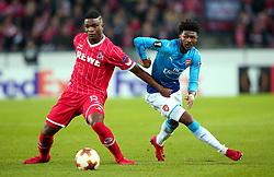 Ainsley Maitland-Niles of Arsenal goes past Jhon Cordoba of Cologne - Mandatory by-line: Robbie Stephenson/JMP - 23/11/2017 - FOOTBALL - RheinEnergieSTADION - Cologne,  - Cologne v Arsenal - UEFA Europa League Group H