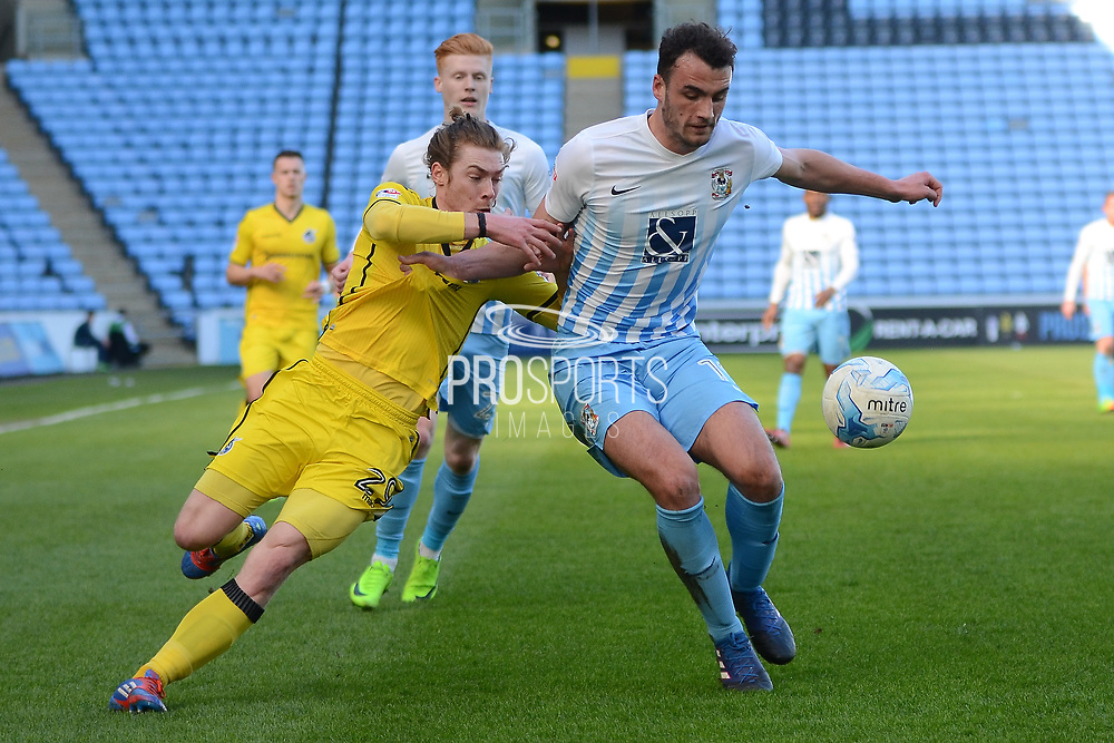 Bristol Rovers forward Luke James (29) and Coventry City defender Farrend Rawson (19) battle for possession 0-0  during the EFL Sky Bet League 1 match between Coventry City and Bristol Rovers at the Ricoh Arena, Coventry, England on 25 March 2017. Photo by Alan Franklin.