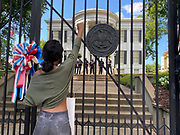 6/6/2020 Jackson MS. <br /> Student Maisie Brown 18yrs old from Jackson organized a peaceful protest outside the Governors Mansion. She said there voices would be heard and her face would be seen- change is coming. The protest was in honor of George Floyd, another Black man killed by the knees and hands of 4 former Minneapolis Minnesota police officers. The protestors are demanding an end to police brutality  and systematic racism among other issues in Mississippi and America. Protests have broken out around the world in solidarity to end white supremacy and police brutality after the death of Georg Floyd.<br /> <br /> The National Black Panthers Party from Tupelo Mississippi showed up outside the Governors mansion in the shadow of the State Capitol to protest police brutality. The National Black Panthers Party was their to show their support for change in Mississippi, to end systemic racism and police brutality.  The Panthers showed up at the end of a peaceful protest organized by 18yr old student Maisie Brown. The brutal murder of African American George Floyd by the knee and hands of 4 former Minneapolis Minnesota police officers has sparked a cry for justice and reform around the world. Photo copyright © Suzi Altman @suzialtman #mississippi #blm #blacklivesmatter #protest #icantbreathe #georgefloyd #endracism #policebrutality #documentary #history #suzialtman #iphonography #shotoniphone #zumapress #NBPP #panthers #blackpanthers #nationalblackpantherparty