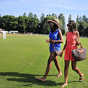 Spectators on the playing field at half time during polo matches during the Airstream vs. Cinque Terre Polo match at the Greenwich Polo Club, Greenwich, Connecticut, USA. 23rd June 2013. Photo Tim Clayton