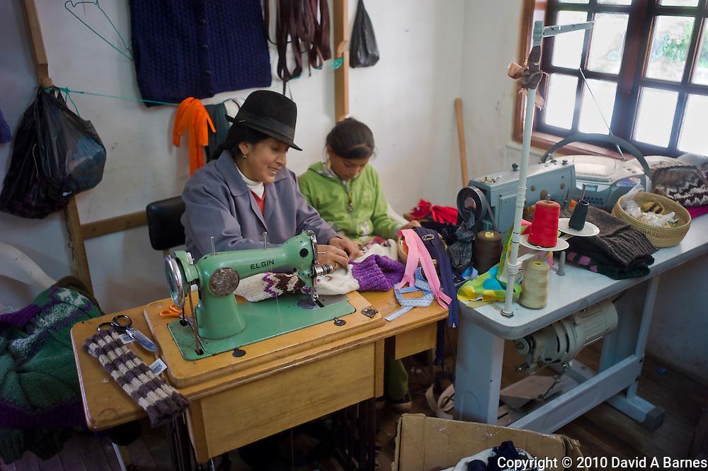 Woman and child sewing in garment coop of Salinas de Guaranda, Ecuador