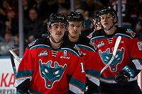 KELOWNA, CANADA - NOVEMBER 25: Dillon Dube #19, Carsen Twarynski #18 and Kaedan Korczak #6 of the Kelowna Rockets skate to the bench against the Medicine Hat Tigers on November 25, 2017 at Prospera Place in Kelowna, British Columbia, Canada.  (Photo by Marissa Baecker/Shoot the Breeze)  *** Local Caption ***