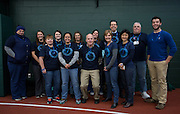 The Diabetes and Endicronology office pose together in their shirts as they prepare for the Blue Circle for Diabetes event at the Walter Fieldhouse at Ohio University on Friday, November 14, 2014.