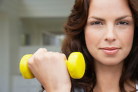 Woman lifting weight head and shoulders