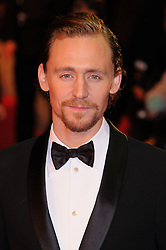 Tom Hiddleston attends the UK premiere of War Horse at Odeon Leicester Square, London, Sunday January 8, 2012. Photo By i-Images..