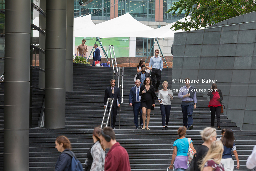 Londoners walk up and down steps at Broadgate in the City of London - the capital's financial district - on 20th August 2018, in London, England.
