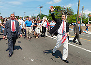 MAY 30, 2011 - Little Neck, New York, U.S. - New York Governor ANDREW CUOMO (Democrat) waving to crowds as he marches in Little Neck-Douglaston Memorial Day Parade, which honors America's veterans, on Northern Boulevard.