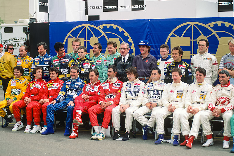 PHOENIX -  MARCH 1991:  Formula One drivers sit for a pre-race group photo before the Formula One United States Grand Prix held in Phoenix, Arizona in March 1991.  Notable drivers in the group include Ayrton Senna in blue polo shirt and cap (center rear), Alain Prost and Jean Alesi of Ferrari (second and third from left, front row), and Nigel Mansell of Williams-Renault (fourth from left, front row).  (Photo by David Madison/Getty Images) *** Local Caption *** Alain Prost;Jean Alesi;Nigel Mansell;Ayrton Senna
