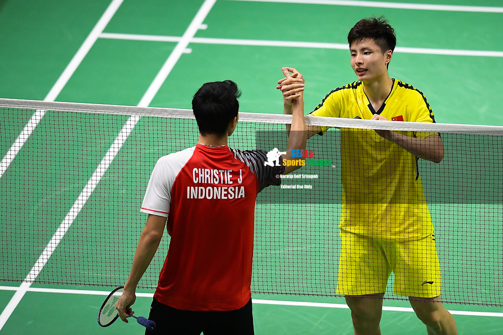 BANGKOK, THAILAND - MAY 25: Shi Yuqi of China shake hand on Court 1 after winning his Semi-Finals match against Jonatan Christie of Indonesia at the BWF Total Thomas and Uber Cup Finals 2018, Impact Arena , Bangkok, Thailand on May 25, 2018.<br /> .<br /> .<br /> .<br /> Photo by: Naratip Golf Srisupab/SEALs Sports Images<br /> <br /> .<br /> All photo must include a credit line adjacent to the content: Naratip Golf Srisupab/SEALs Sports Images
