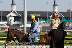 Tommy Floyd, left, and his daughter Isabella from Louisville watch horses workouts Tuesday, April 30, 2013 at Churchill Downs in Louisville. Photo by Justin Gilliland
