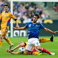 05 September 2009: French forward Yoann Gourcuff  is tackled by Romanian midfielder Tiberiu Ghioane during the World Cup 2010 qualifying football match France vs. Romania (1-1), on September 5, 2009 at the Stade de France stadium in Saint-Denis, near Paris, France.