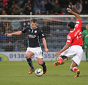 Ross County's Jamie Reckord flies in to try to tackily Dundee's Paul McGowan- Dundee v Ross County, SPFL Premiership at Dens Park<br /> <br />  - &copy; David Young - www.davidyoungphoto.co.uk - email: davidyoungphoto@gmail.com