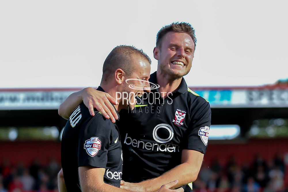York City midfielder James Berrett celebrates with goalscorer York City midfielder Luke Summerfield during the Sky Bet League 2 match between Stevenage and York City at the Lamex Stadium, Stevenage, England on 12 September 2015. Photo by Simon Davies.