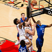 03 February 2018: The San Diego State Aztecs look to rebound after a couple losses against Air Force Saturday night. San Diego State Aztecs center Kameron Rooks (45) tips in a rebound for a bucket while being defended by Air Force Falcons forward Lavelle Scottie (12) in the first half. The Aztecs lead 35-21 at the half at Viejas Arena.<br /> More game action at www.sdsuaztecphotos.com