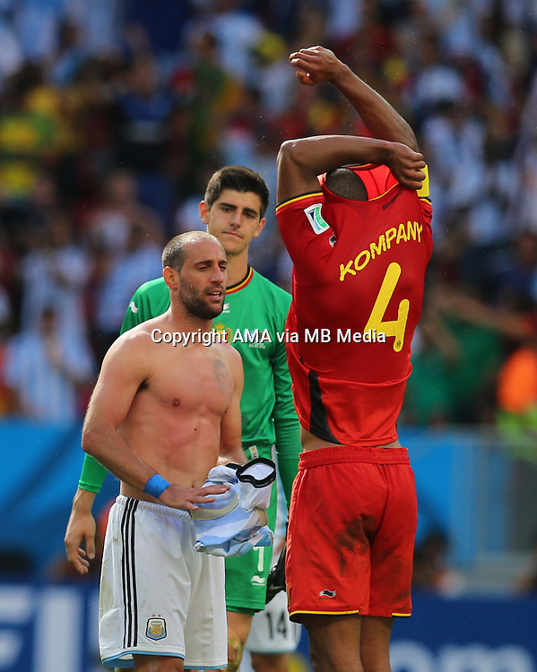 Vincent Kompany of Belgium swaps shirts with Manchester City team mate Pablo Zabaleta of Argentina