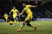 AFC Wimbledon defender Darius Charles (32) crosses during the EFL Sky Bet League 1 match between Gillingham and AFC Wimbledon at the MEMS Priestfield Stadium, Gillingham, England on 21 February 2017.