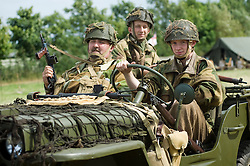 Re-enactors from the Northern World War Two Association Living History group portraying a British Paratrooper from the 22nd Independent Company, 6th Airborne Parachute Regiment in a replica Willys Jeep based on Suzuiki running gear. SPAM 1940's Weekend. Heckmonwyke near Wakefield 10 July 2010 .Images © Paul David Drabble