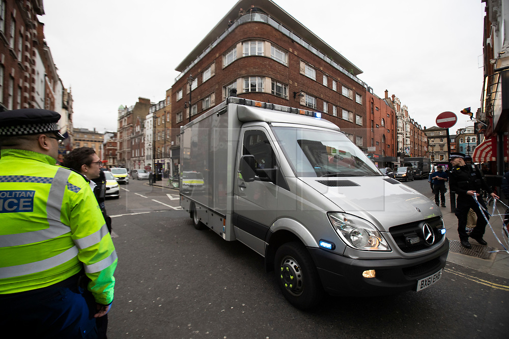 © Licensed to London News Pictures. 04/02/2020. London, UK. Explosive Ordnance Disposal officers arrive in Dean Street in Soho which remains closed for a second day after a part of an Unexploded WW II Bomb was discovered . Photo credit: George Cracknell Wright/LNP