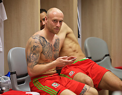 HAIFA, ISRAEL - Saturday, March 28, 2015: Wales' David Cotterill in the dressing room after the UEFA Euro 2016 qualifying Group B match against Israel at the Sammy Ofer Stadium. (Pic by David Rawcliffe/Propaganda)