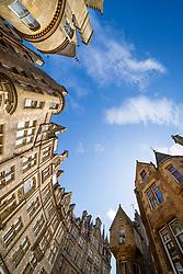 Looking up at tenement apartment buildings on Cockburn Street in Edinburgh Old Town, Scotland, UK