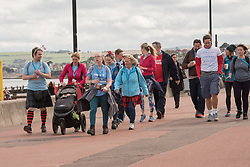 The Edinburgh Kiltwalk passed along Portobello Prom this lunchtime. Amongst the walkers, raising funds for a wide range of charities, were Portobello's four councillors, walking together in their fundraising efforts for the Thistle Foundation.  Calum Laidlaw started the 24-mile Mighty Stride in Holyrood Park while the other three councillors - Maureen Child, Mary Campbell and Kate Campbell - started the 15.5-mile Big Stroll in Musselburgh.<br /> &copy; Jon Davey/ EEm